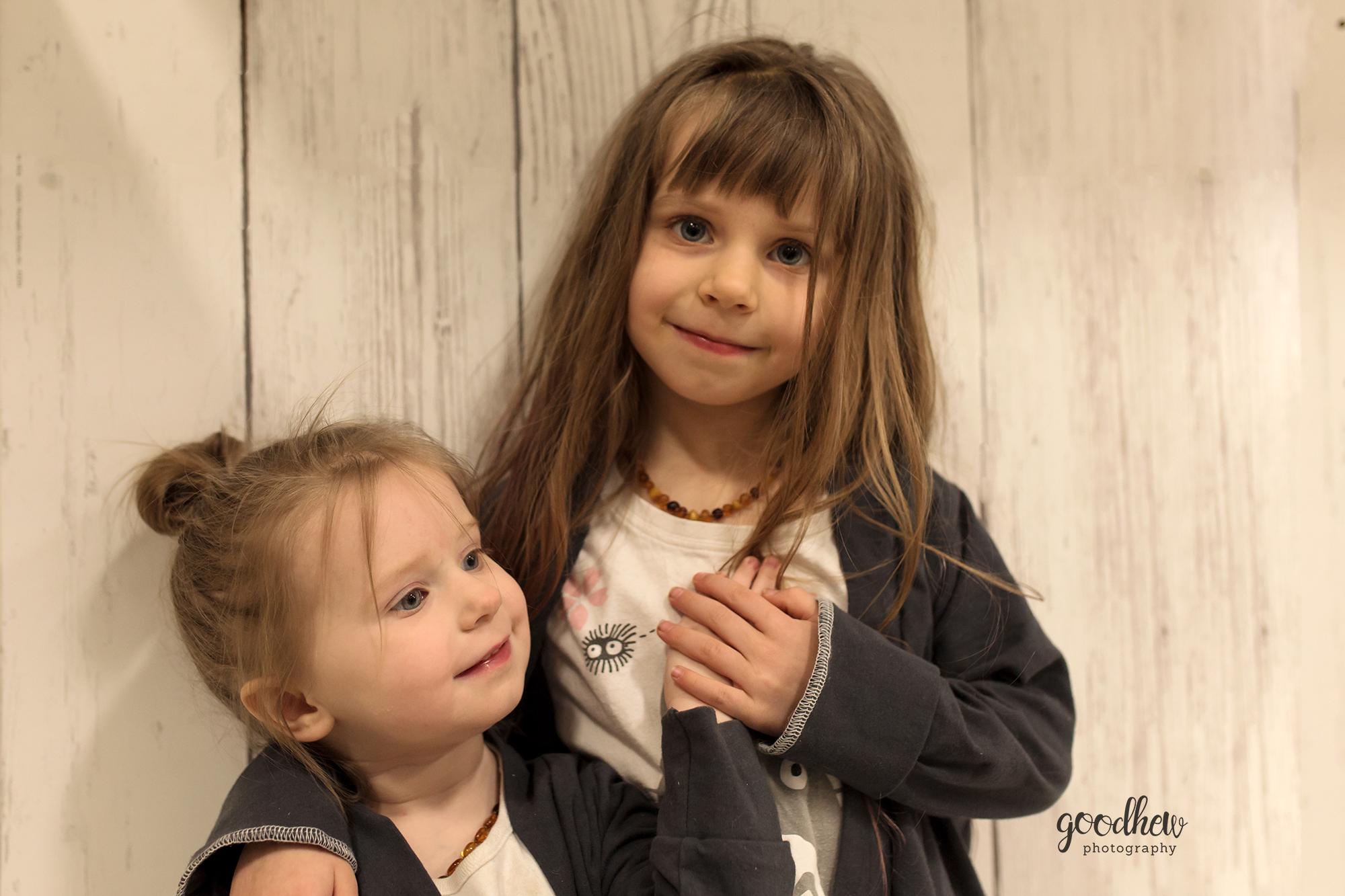 Ann Arbor Children's Portraits - #MichaelsChallenge - Sisters against a faux wood backdrop